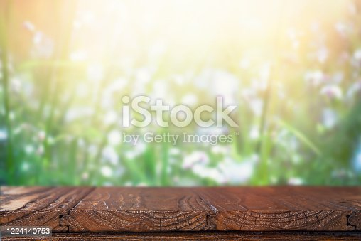 1048926386 istock photo Empty Rustic Wooden Table with Defocused Background. 1224140753
