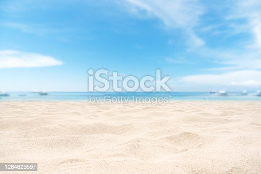 istock Empty sand beach with clear sky background 1264629597