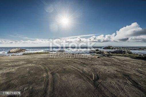 Empty sand beach with tyre tracks against sky, carmel beach,California,USA.