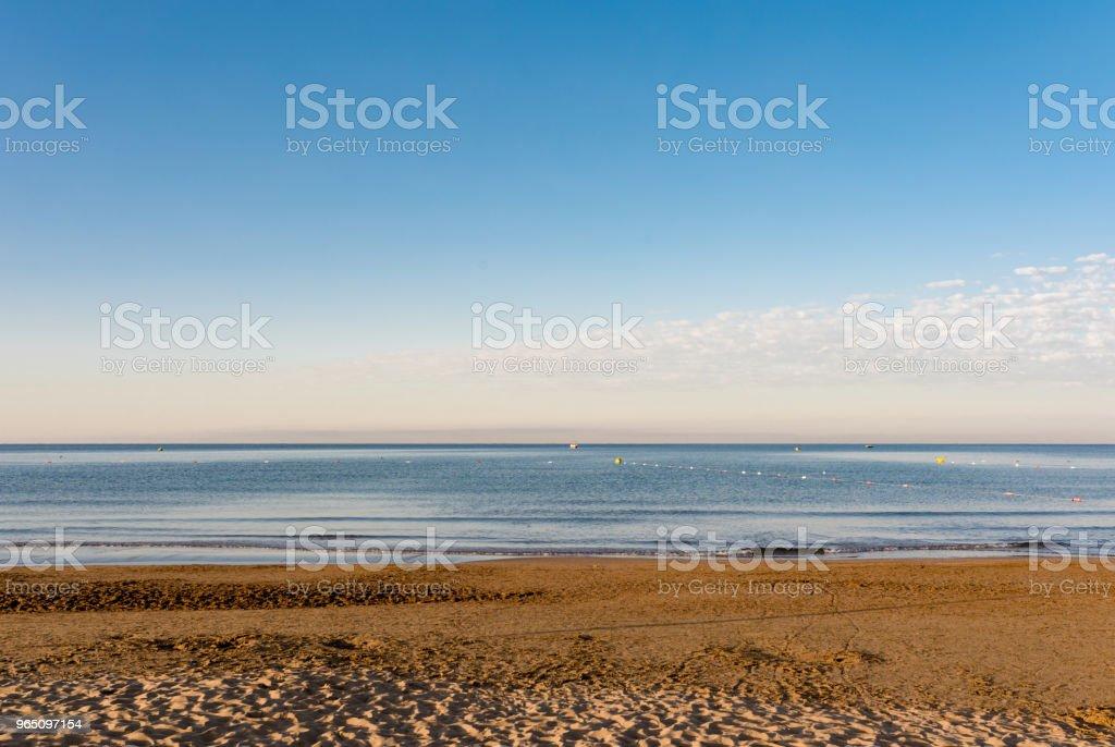 empty sandy beach and sea in sunrise zbiór zdjęć royalty-free