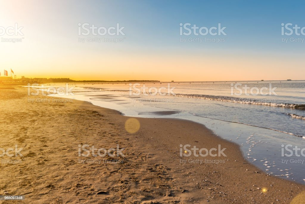 empty sandy beach and sea in sunrise royalty-free stock photo