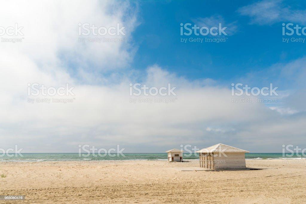 Empty sandy beach with closed bars royalty-free stock photo