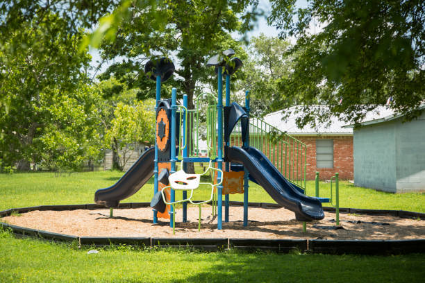 Empty school or neighborhood park playground. Empty playground equipment at school or neighborhood park.  No people.  COVID-19, loneliness, child abuse, childhood, education concepts. covid-19 stock pictures, royalty-free photos & images