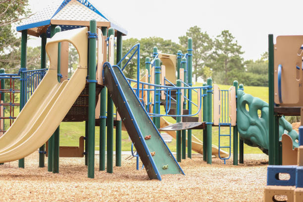 Empty school or park playground. Empty playground equipment at school or park.  No people.  COVID-19, loneliness, child abuse, childhood, education concepts. covid-19 stock pictures, royalty-free photos & images