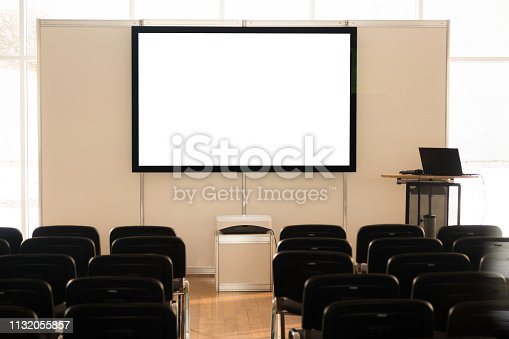 1064053478 istock photo Empty screen in conference room, meeting room, boardroom, Classroom, Office, with white projector board. 1132055857