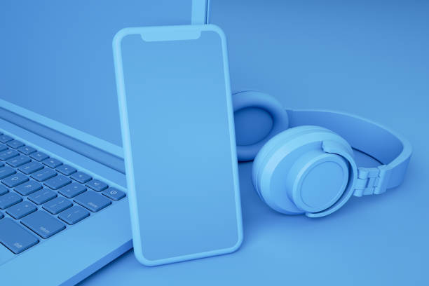 Empty Screen Smartphone and Laptop on Blue Background - foto stock