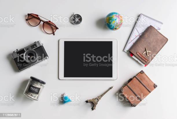 Empty screen tablet with travel accessories and items on white with picture id1128682811?b=1&k=6&m=1128682811&s=612x612&h=9fxx9kvycohotn2fbnx8pvn45hvs96sf46p172f obm=