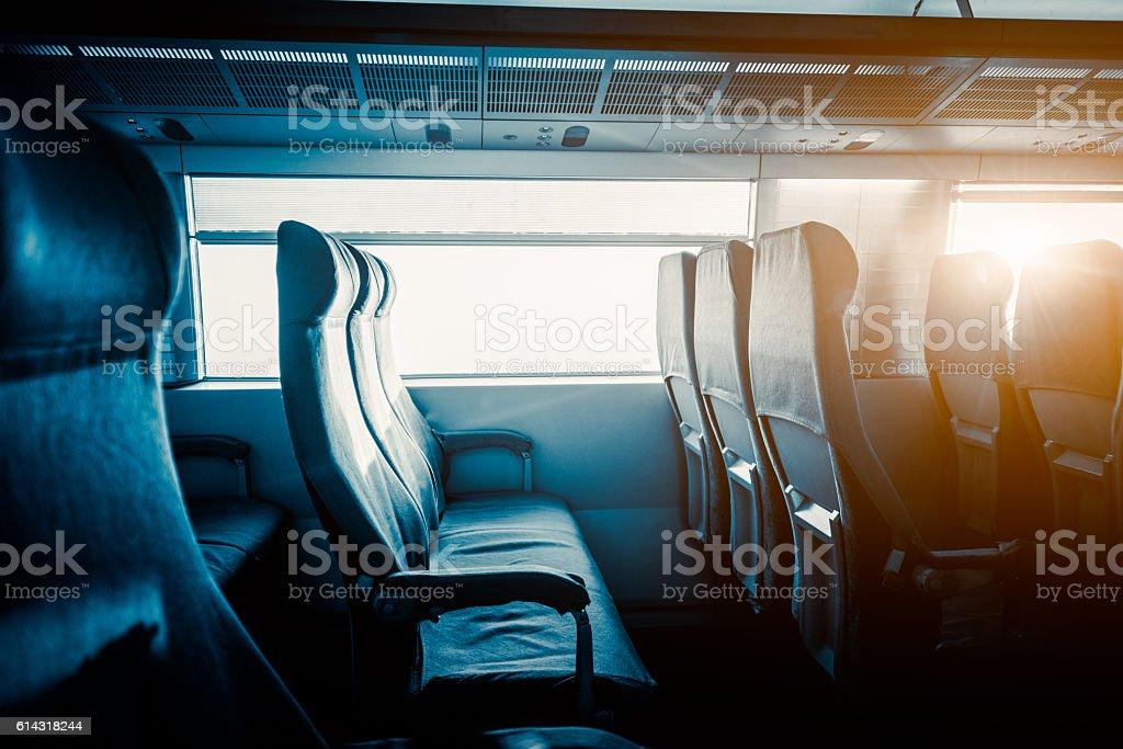 Empty Seats By Window In Train stock photo