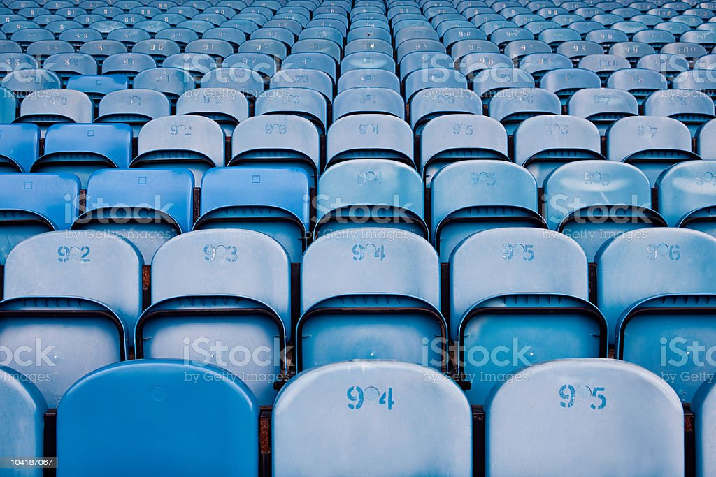 Empty seats in football stadium stock photo