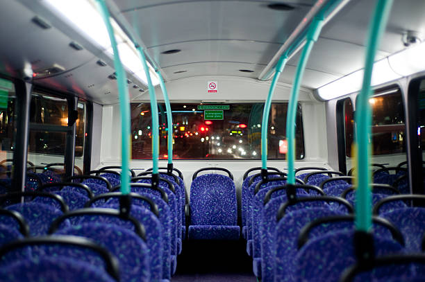 Empty seats Rows of empty blue seats on a London Double Decker Bus at night vehicle seat stock pictures, royalty-free photos & images