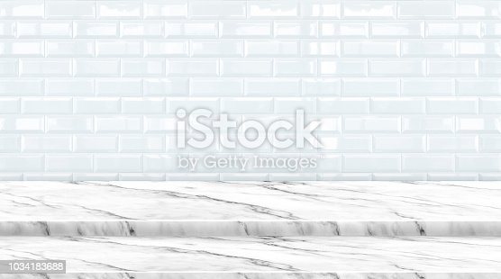 istock Empty setp marble marble table top with white ceramic tile wall background,Mock up banner ads for display of product or your design,Luxury modern theme. 1034183688