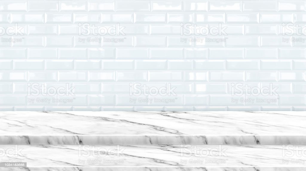 Empty setp marble marble table top with white ceramic tile wall background,Mock up banner ads for display of product or your design,Luxury modern theme. stock photo