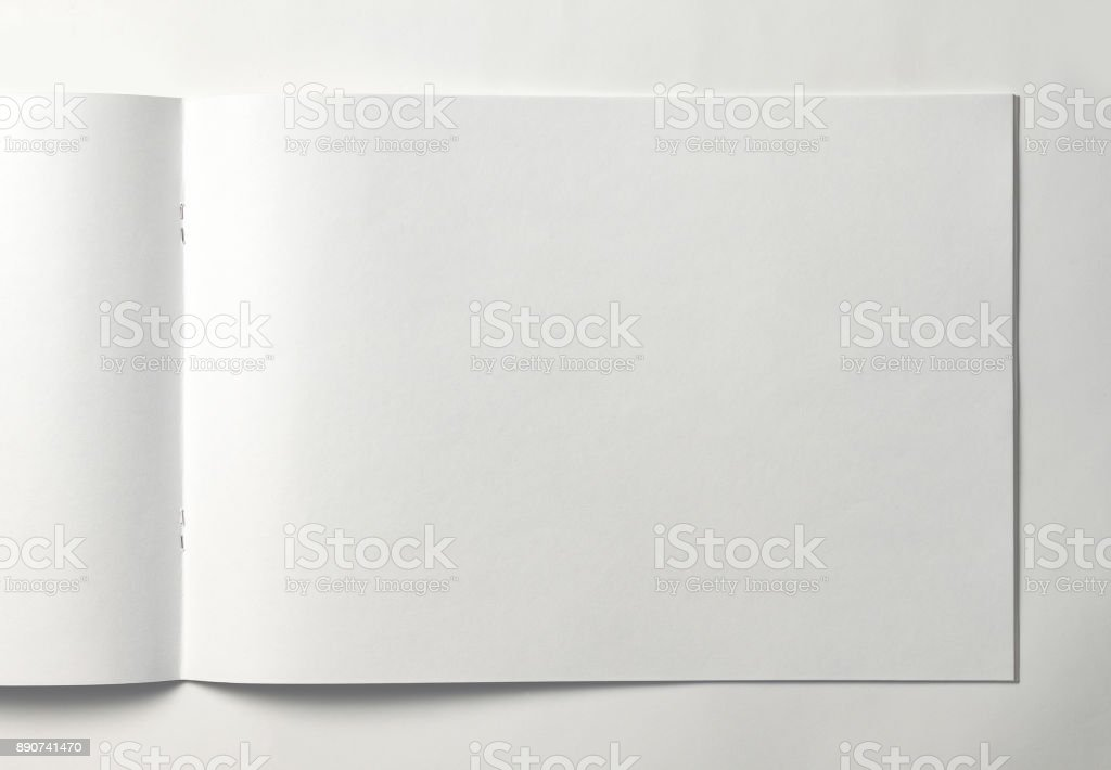 Empty sheet of sketchbook or album for drawing on white background. stock photo