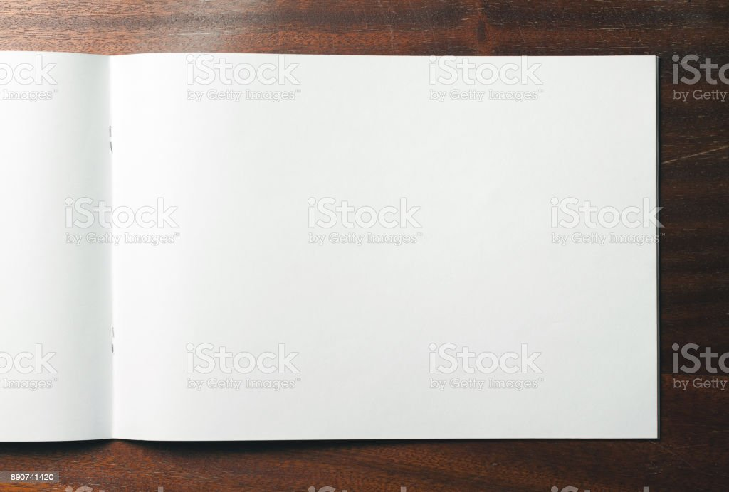 Empty sheet of sketchbook or album for drawing on wooden background. stock photo