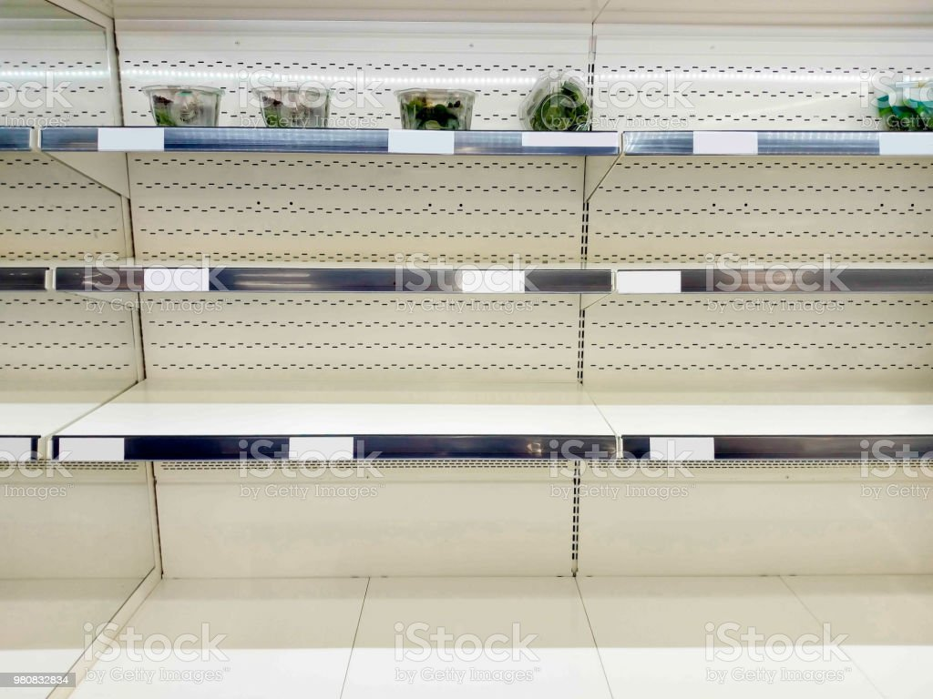 Empty shelf in grocery store royalty-free stock photo
