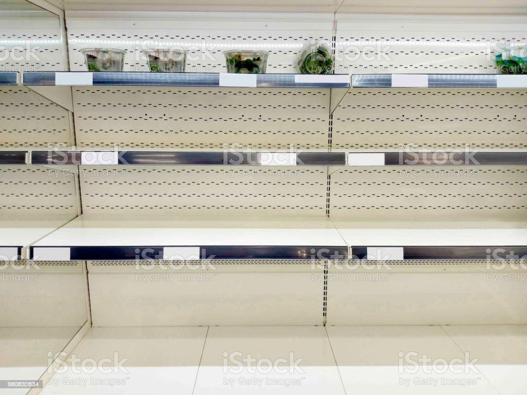 Empty shelf in grocery store stock photo