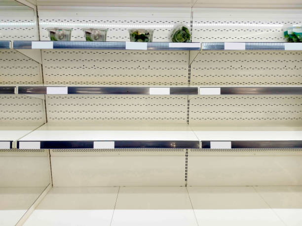 Empty shelf in grocery store stock photo