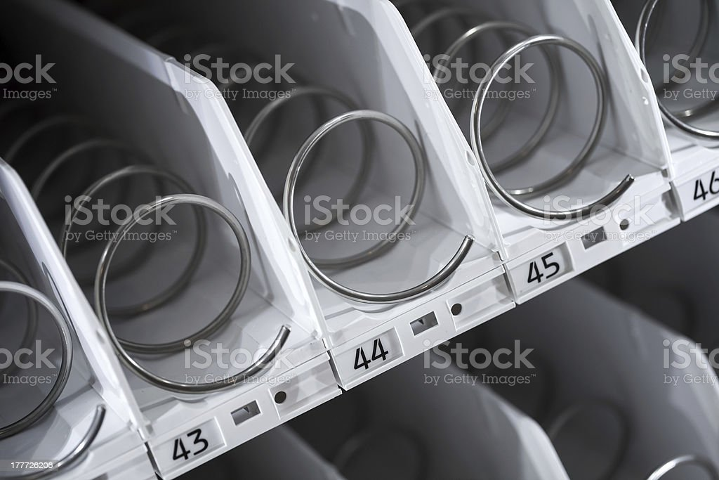 Empty shelf of vending machine stock photo