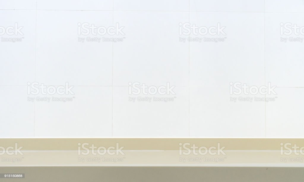 Empty shelf on white brick wall background. stock photo
