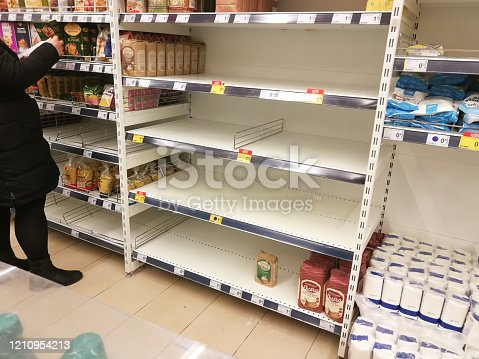 KAUNAS, LITHUANIA - FEBRUARY 29, 2020: Empty shelves in a Maxima supermarket. Shortages of products and oats supplies during panic of Corona virus.