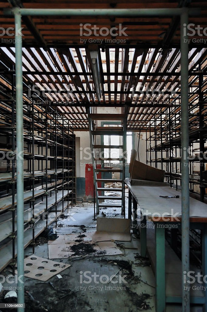 empty shelves in abandoned factory royalty-free stock photo