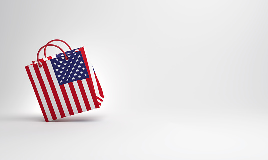 Empty shopping bag color with flag of the United States of America in the studio lighting.