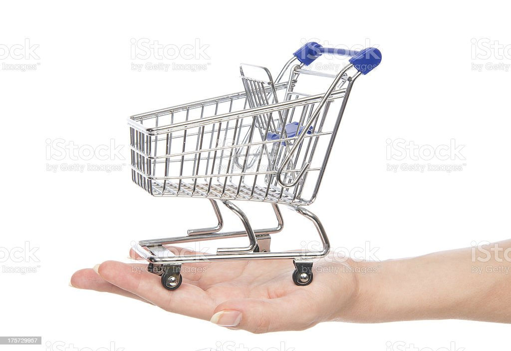 Empty shopping cart for sale on open hand royalty-free stock photo