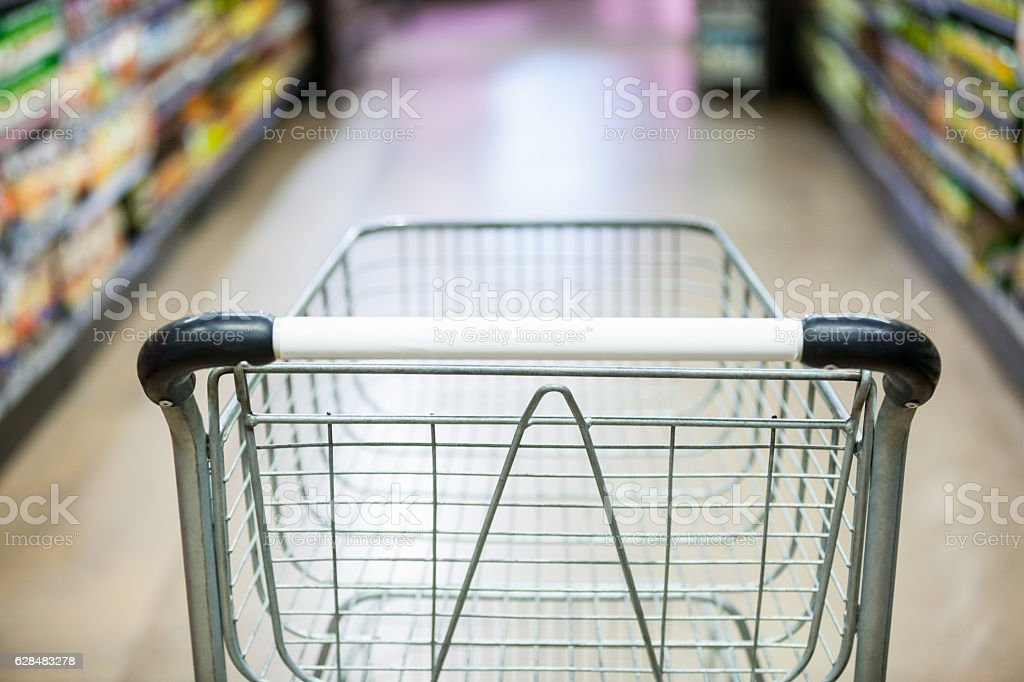 Empty shopping cart in grocery section stock photo