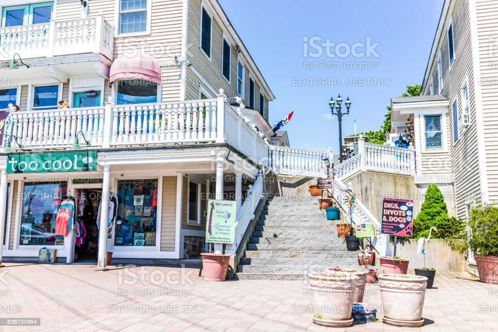 Empty shopping plaza on sidewalk street in downtown village during summer day stock photo