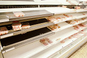 large supermarket selling out of food down the meat aisle