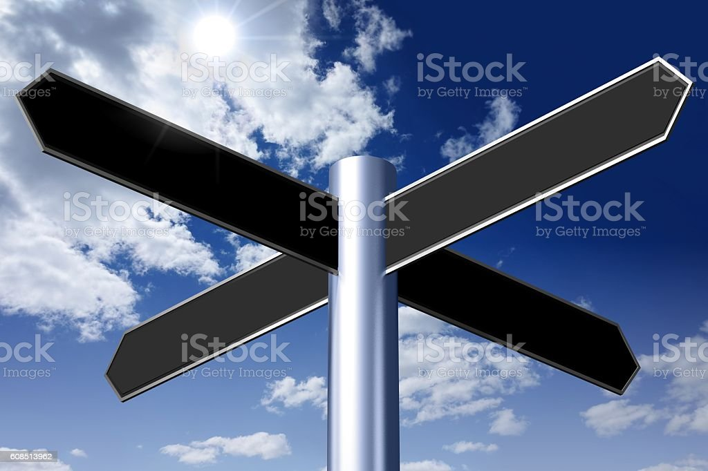 Empty signpost with four black arrows stock photo