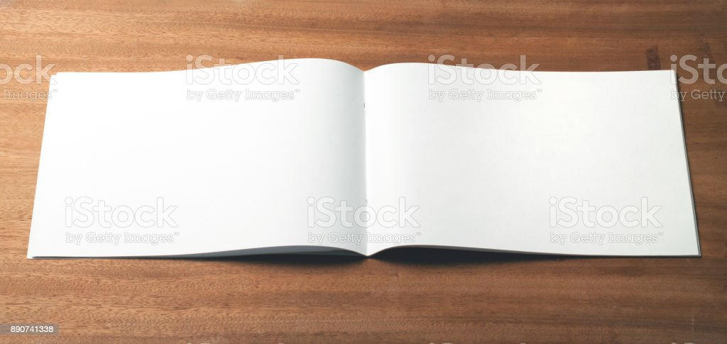 Empty sketchbook or album for drawing on wooden background. stock photo