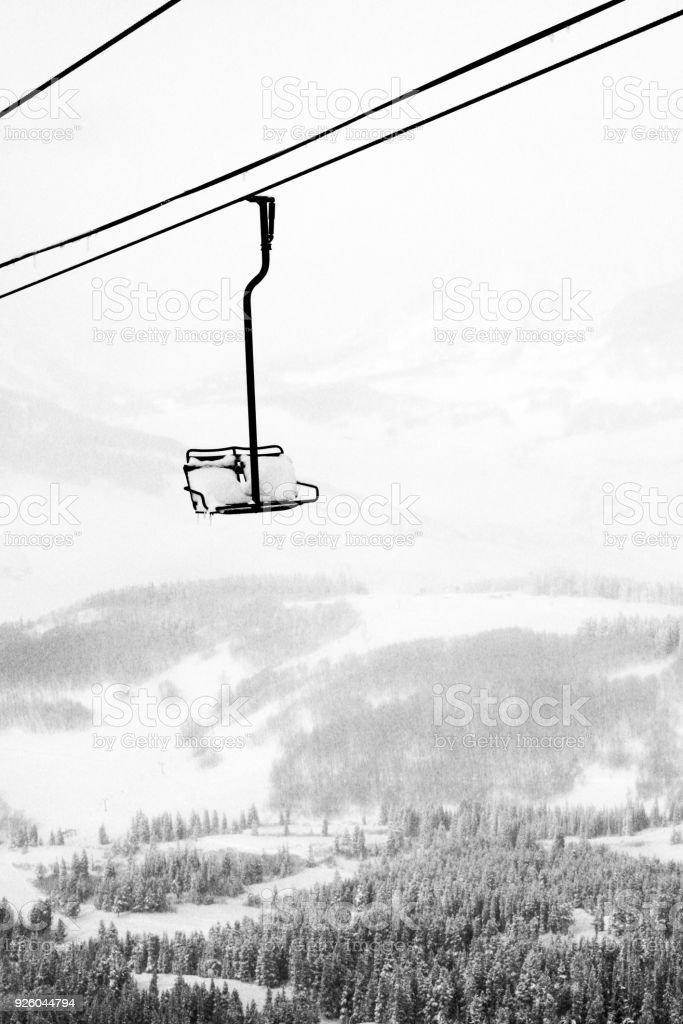 Empty Ski Lift in the Snow in Colorado stock photo