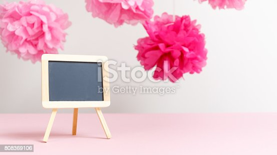 591421282 istock photo Empty small charcoal board at the girl baby shower party.  Baby shower celebration concept 808369106