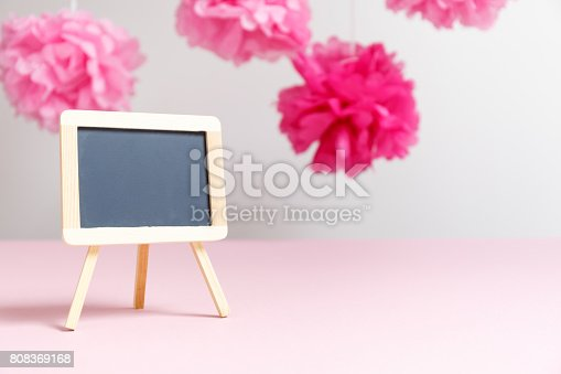 591421282 istock photo Empty small charcoal board at the girl baby shower party.  Baby shower celebration concept 808369168