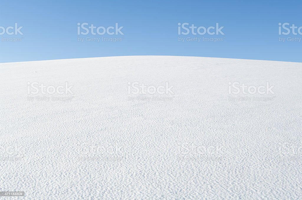 Empty snow-covered field, with distant horizon stock photo