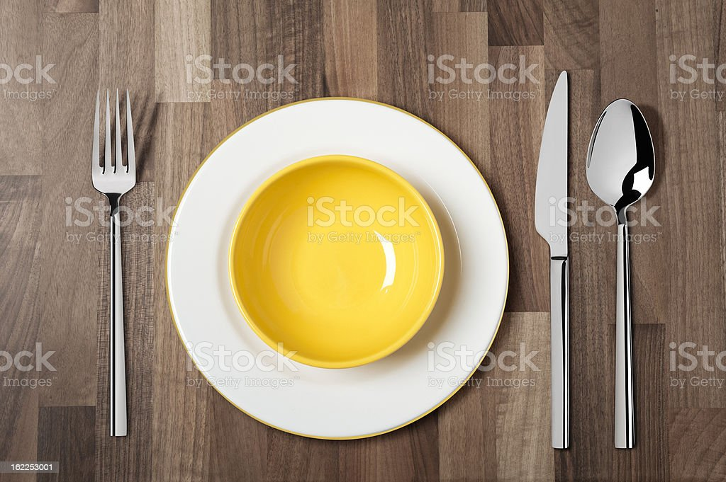 Empty soup bowl with Knife, Spoon and Fork stock photo
