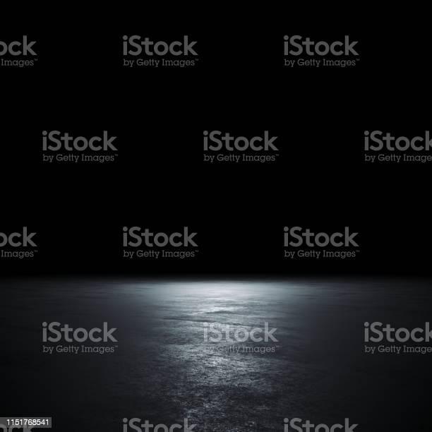 Photo of Empty spot lit dark background