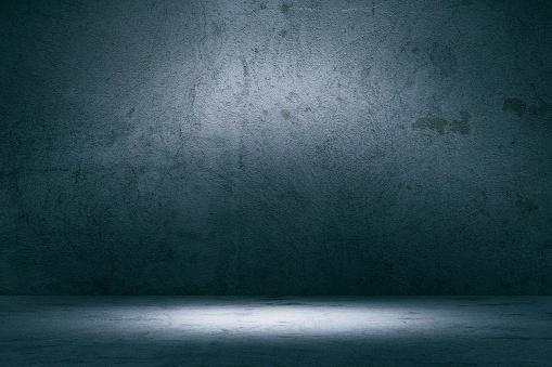 Empty spotlit concrete background.
