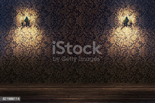 Empty spotlit room with flower pattern wallpaper.