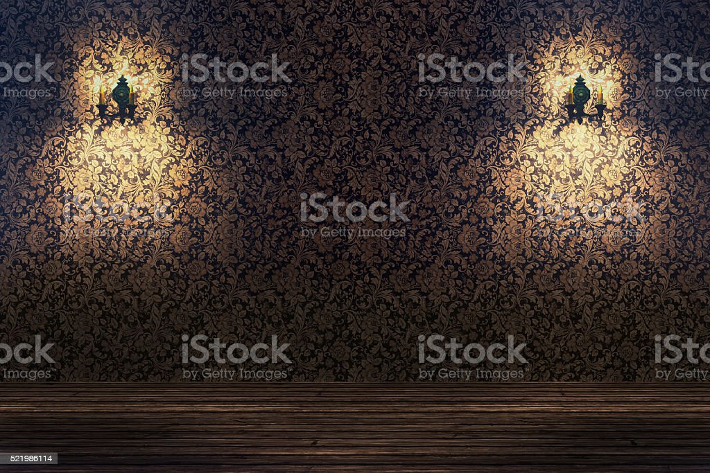 Empty spotlit room with flower pattern wallpaper stock photo