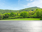 empty square floor and mountain landscape in the nature park