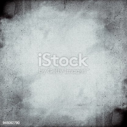 1131841696 istock photo Empty square black and white film frame with heavy grain 945062790