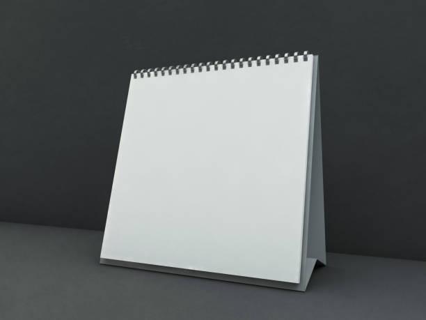 leere quadratische schreibtisch-kalender auf dem tisch. mockup-designkonzept. 3d - menüplanung vorlagen stock-fotos und bilder