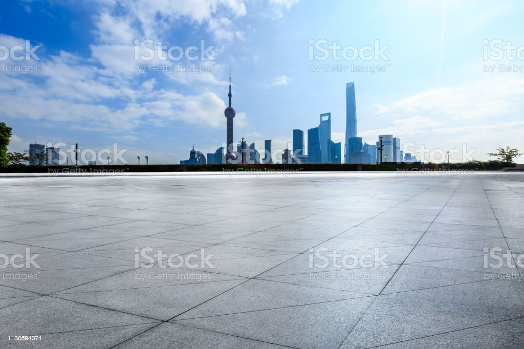 Empty square floor and backlit city skyline in Shanghai stock photo