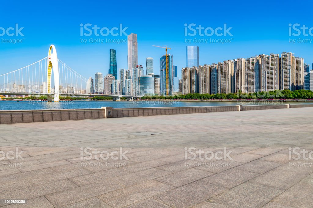 Empty square floor tiles and modern architecture in Guangzhou