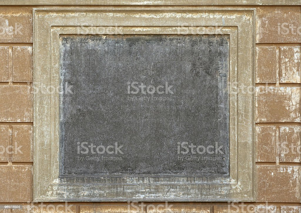 Empty square medallion on ancient wall royalty-free stock photo