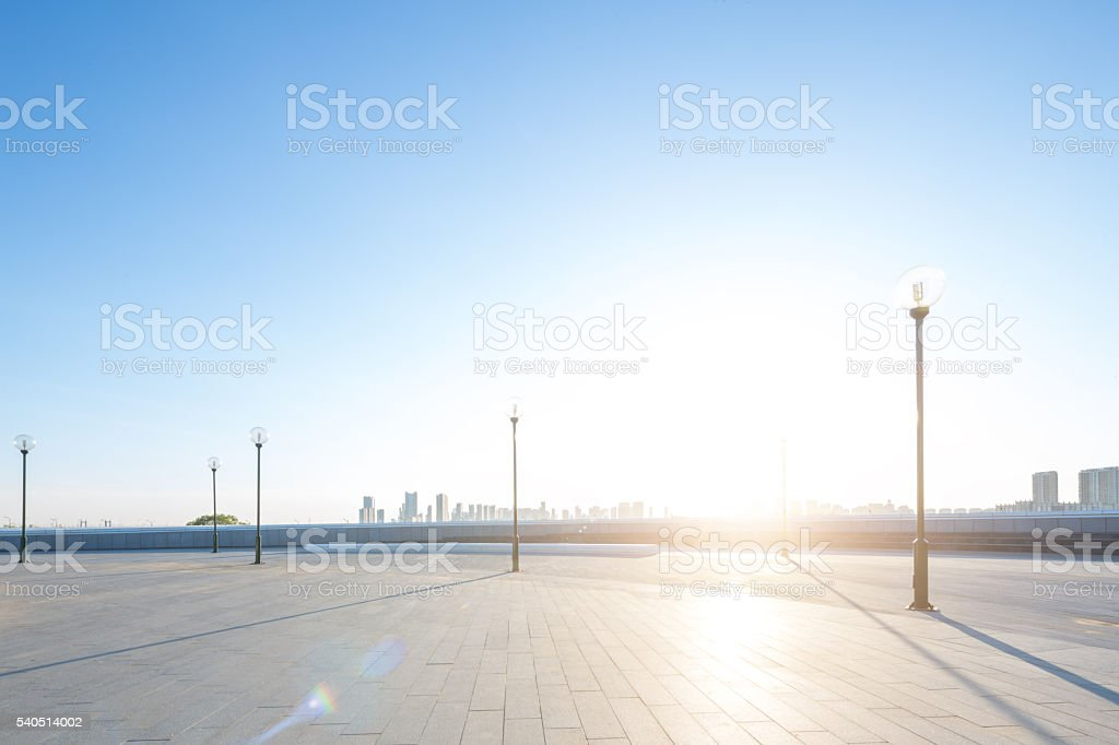 empty square with cityscape and skyline at sunrise in harbin stock photo