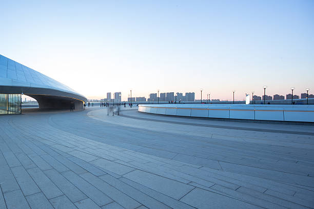 empty square with cityscape and skyline at sunrise in harbin empty square with cityscape and skyline at sunrise in harbin harbin stock pictures, royalty-free photos & images