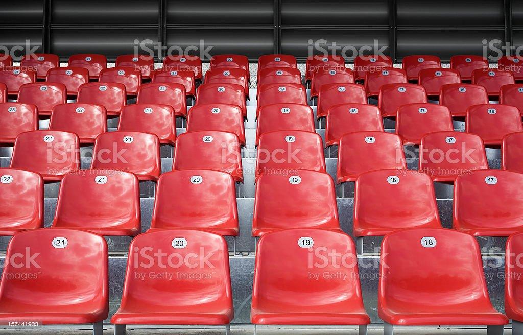 Empty stadium seats stock photo